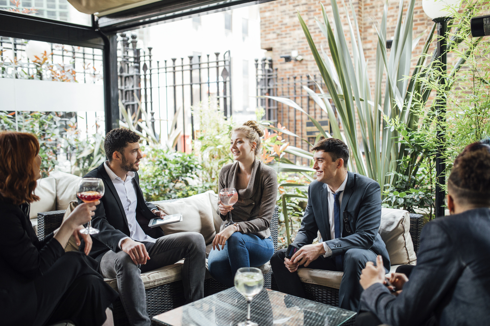 group of business people networking at a social event
