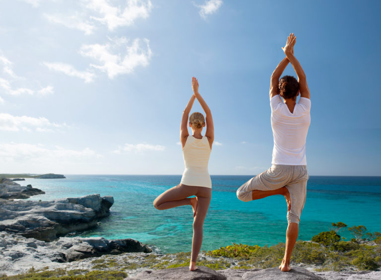 people doing yoga staying fit on vacation