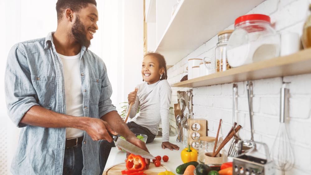 vegan child cooking a vegan meal with dad