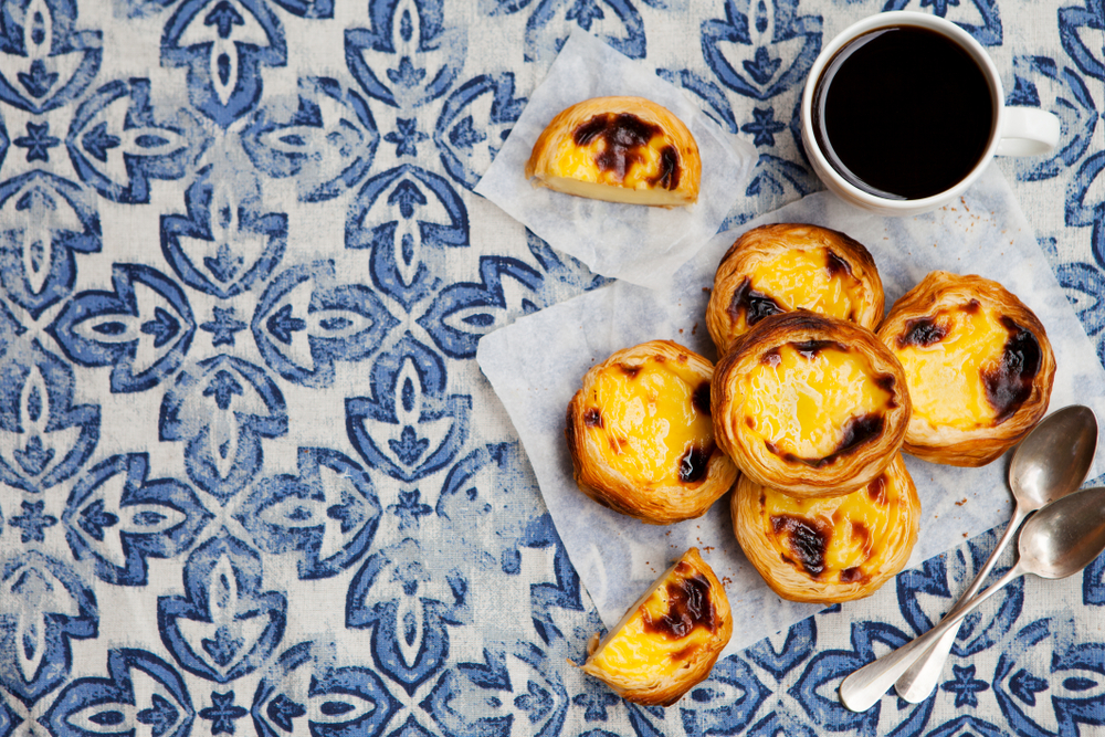 reason to visit lisbon, portugal - enjoy the cuisine like traditional pastel de nata