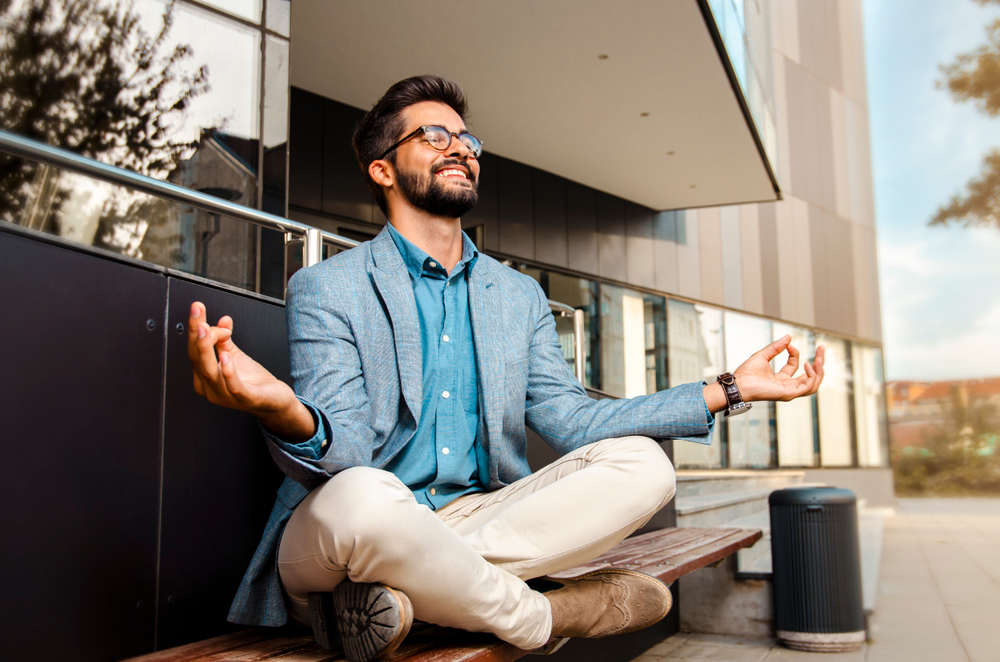 man meditating to stop negative thoughts