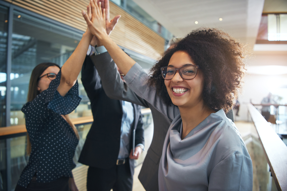 woman leading a group showing how to encourage coworkers