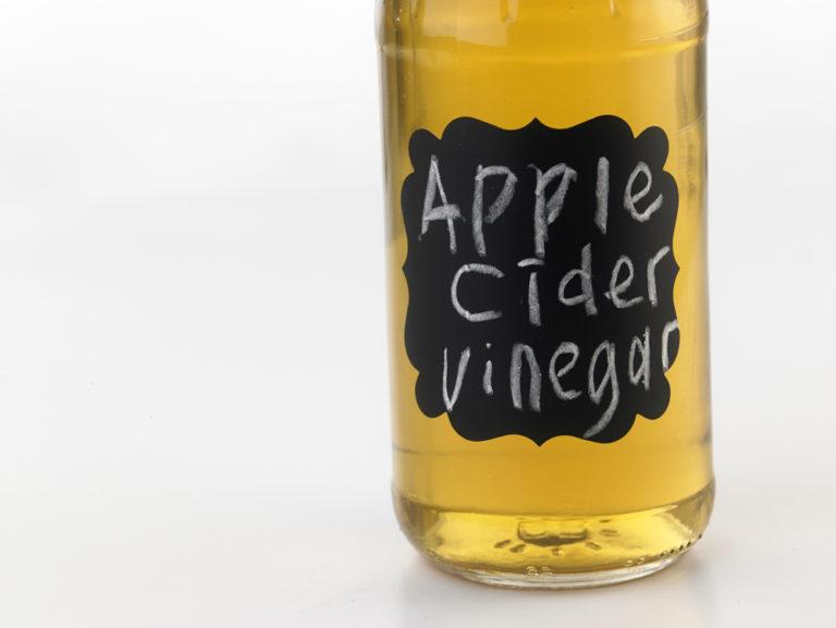bottle of apple cider vinegar with chalkboard label