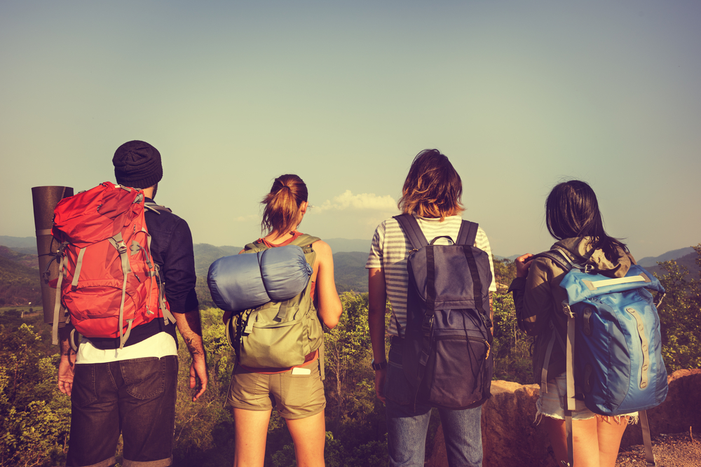group of four travelers with different types of backpacks on - what kind of traveler are you?