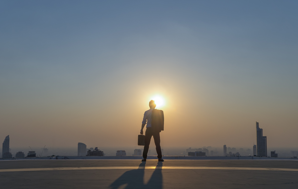 a man standing in the sunlight contemplating being uncomfortable