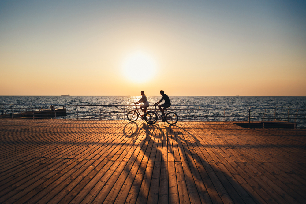 couple riding bikes by the water - setting boundaries in your life