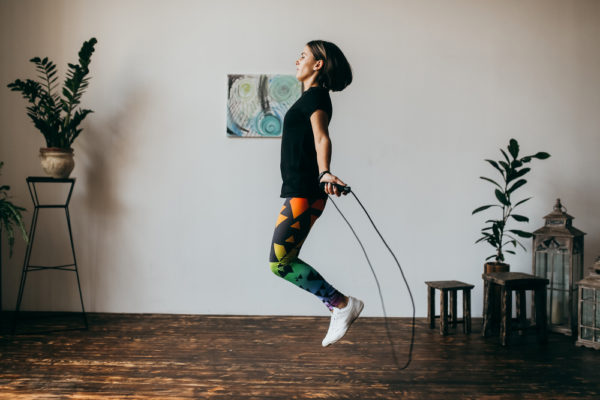 girl doing an at-home workout by jump roping