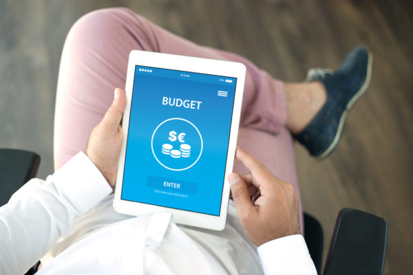 man holding an ipad showing budgeting app