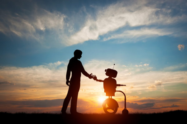 a man shaking hands with a robot
