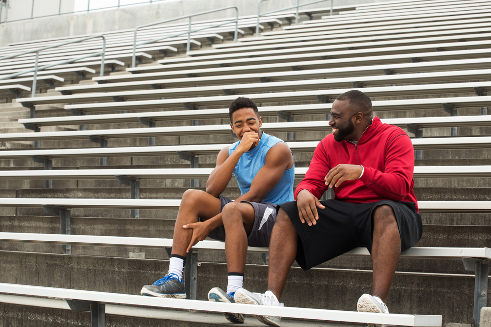 coach spending time mentoring a student athlete - how to be a good mentor