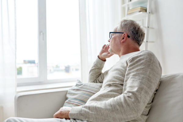 man looking out the window wondering how to deal with a midlife crisis