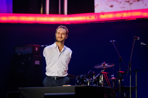 Nick Vujicic on stage as a motivational speaker to help achieve personal success