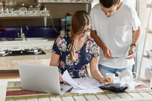 couple managing their finances together - relationship and finances