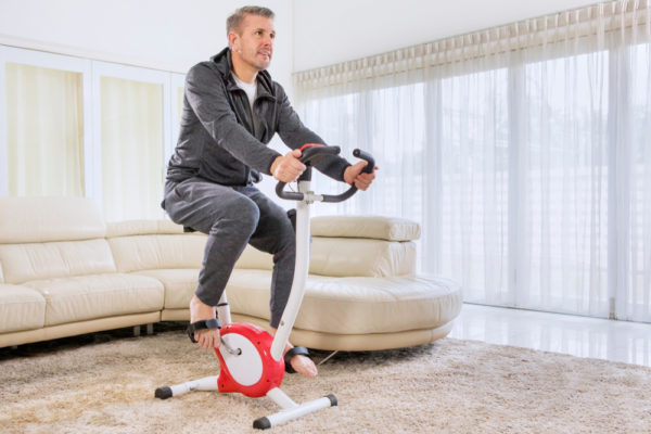 Dude riding an exercise bike
