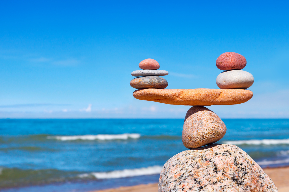 balancing stones by the beach