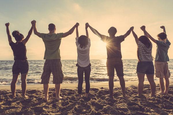 true friendships, friends holding hands watching the sunrise