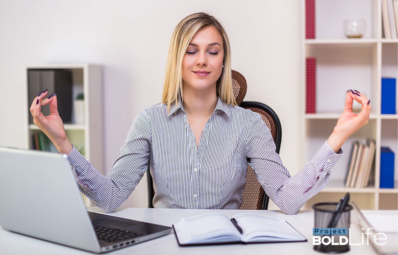 person meditating while working