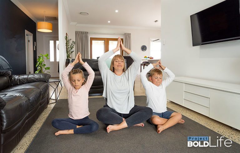 A mom and her two kids meditating