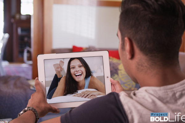 A man and a woman having a virtual date