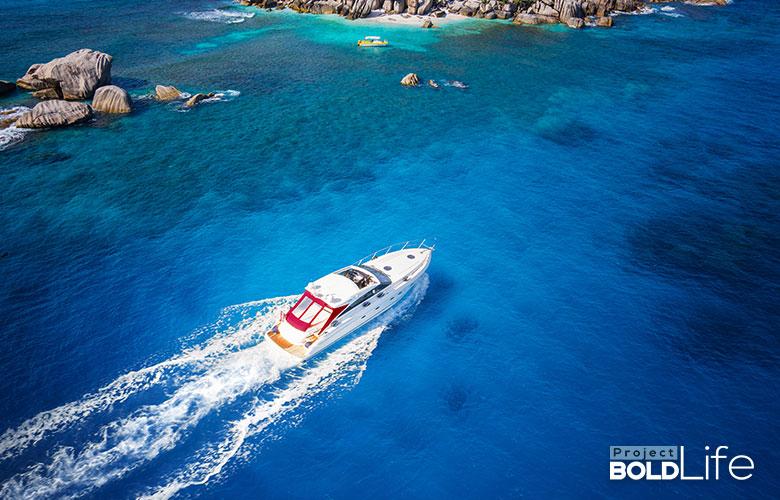 A boat speeding through crystal blue waters
