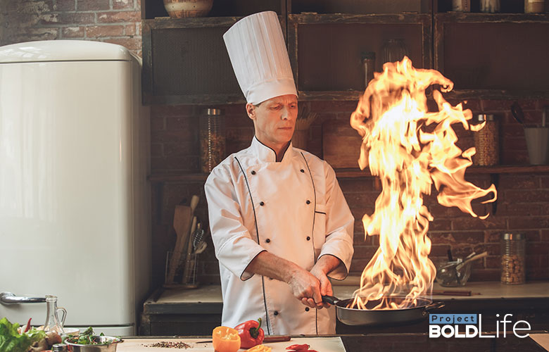 A chef cooking something flambee