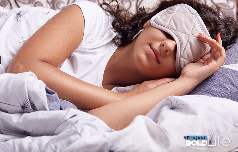 A woman wearing a face mask while she sleeps to hide her identity