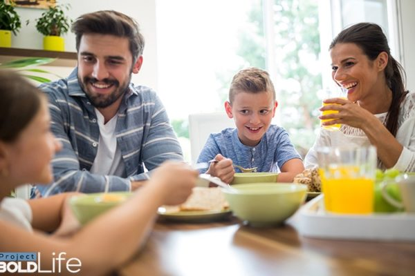 A family eating breakfast and seemingly happy