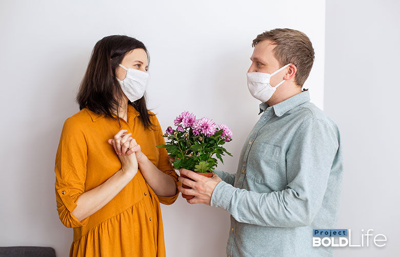 Two people in the height of romance while quarantined