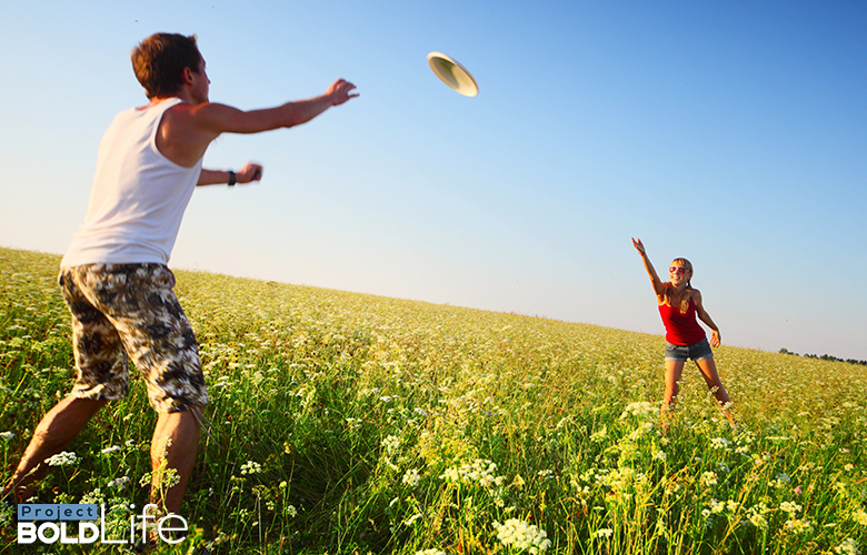 A couple tossing around a frisbee