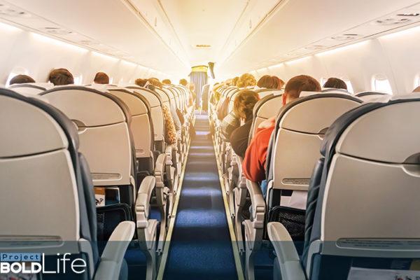 A glowing stewardess on a flight