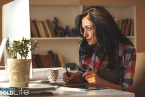 A woman wearing flannel and doing continuing education