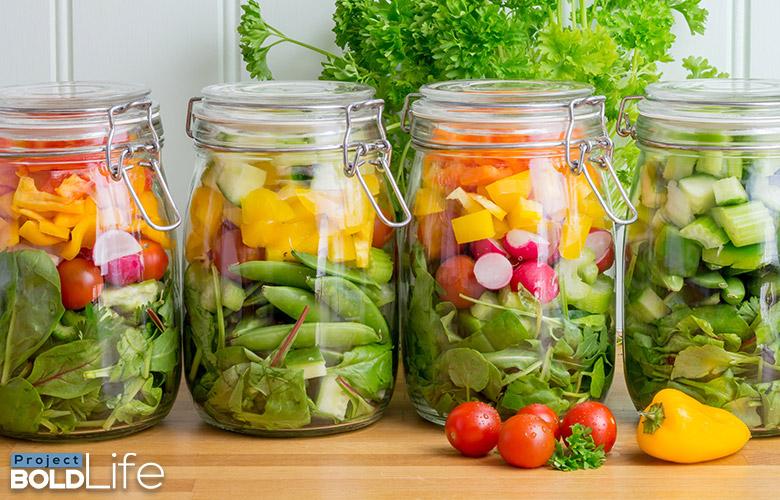 Some salads in mason jars