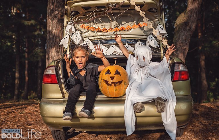 Some kids in costume who live in the trunk of a car