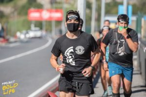 A group of people running with masks on