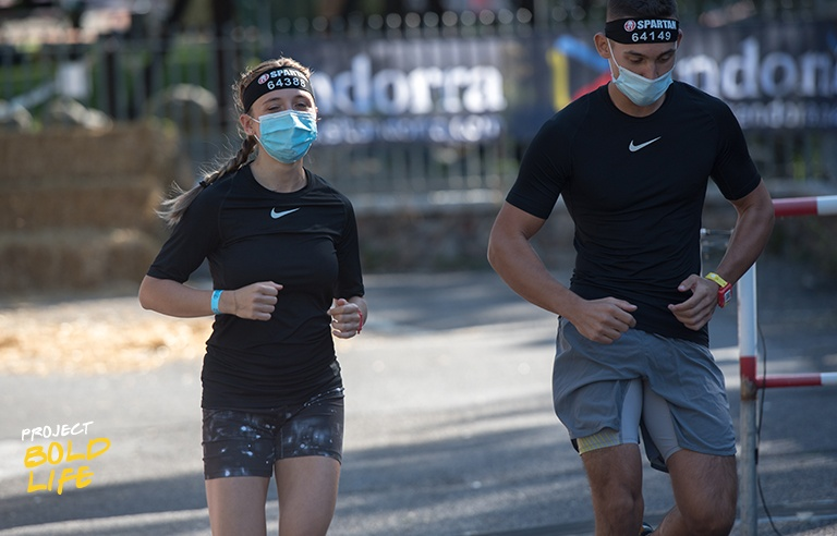 A couple running a race with masks on
