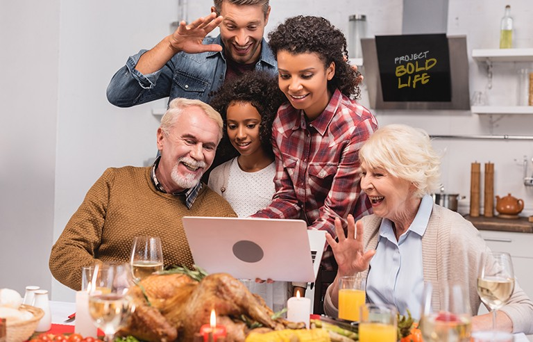 A family gathered around a laptop, getting a jump on Black Friday