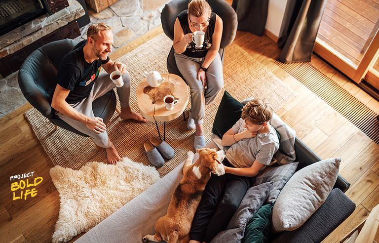 A family all chilling out in their living room
