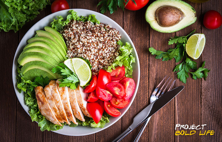 A healthy meal of tomatoes, avocado, chicken and quinoa