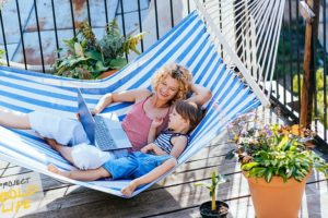 A mom and her kid in a hammock, talking mental health
