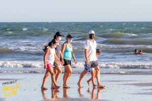 A family walking on the beach, embracing change