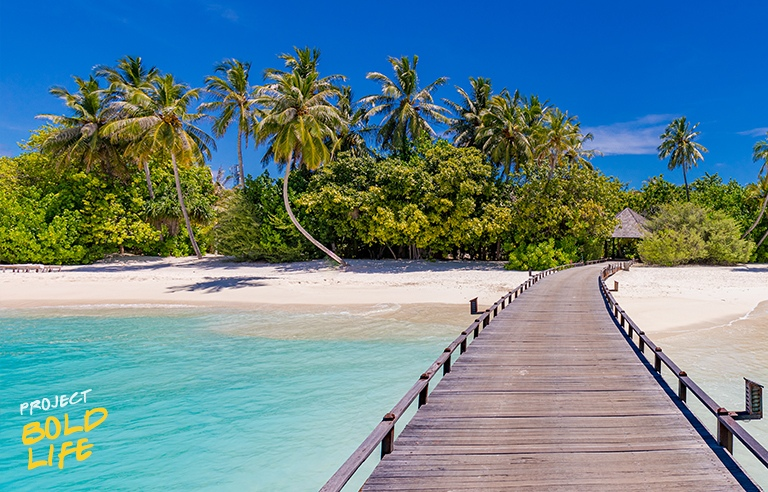 A pretty nice beach with a pier over pristine waters