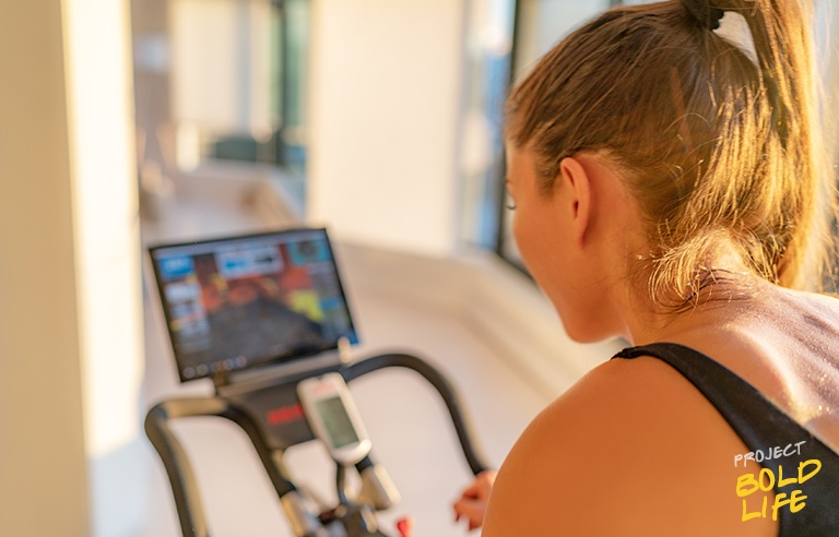 Some woman using her exercise bike to exercise
