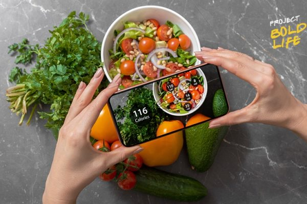 Someone using their phone to analyze their food