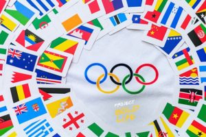 The flags of the world surrounding the Olympic rings